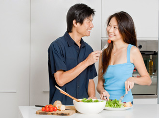 A young couple share a healthy salad