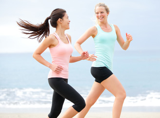 Young women jog on the beach